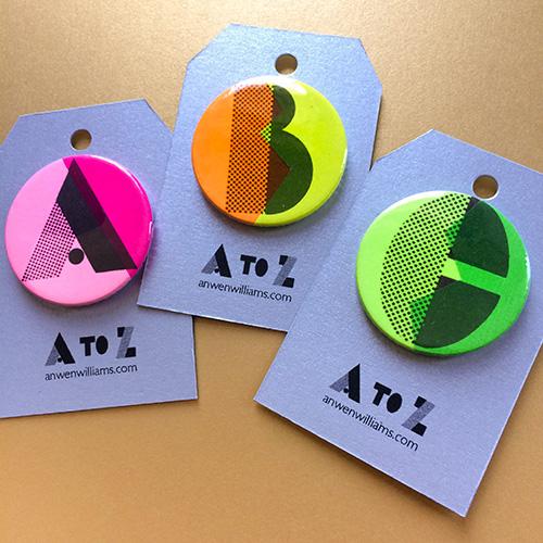 Neon A-Z badges.
